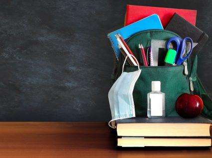 poupar com material escolar