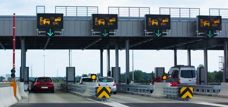 Photo taken from vehicle approaching a toll booth station