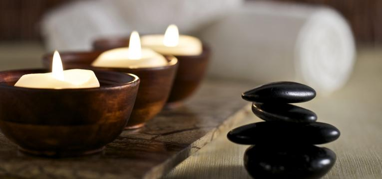 Candles and Massage Stones in a Zen Spa