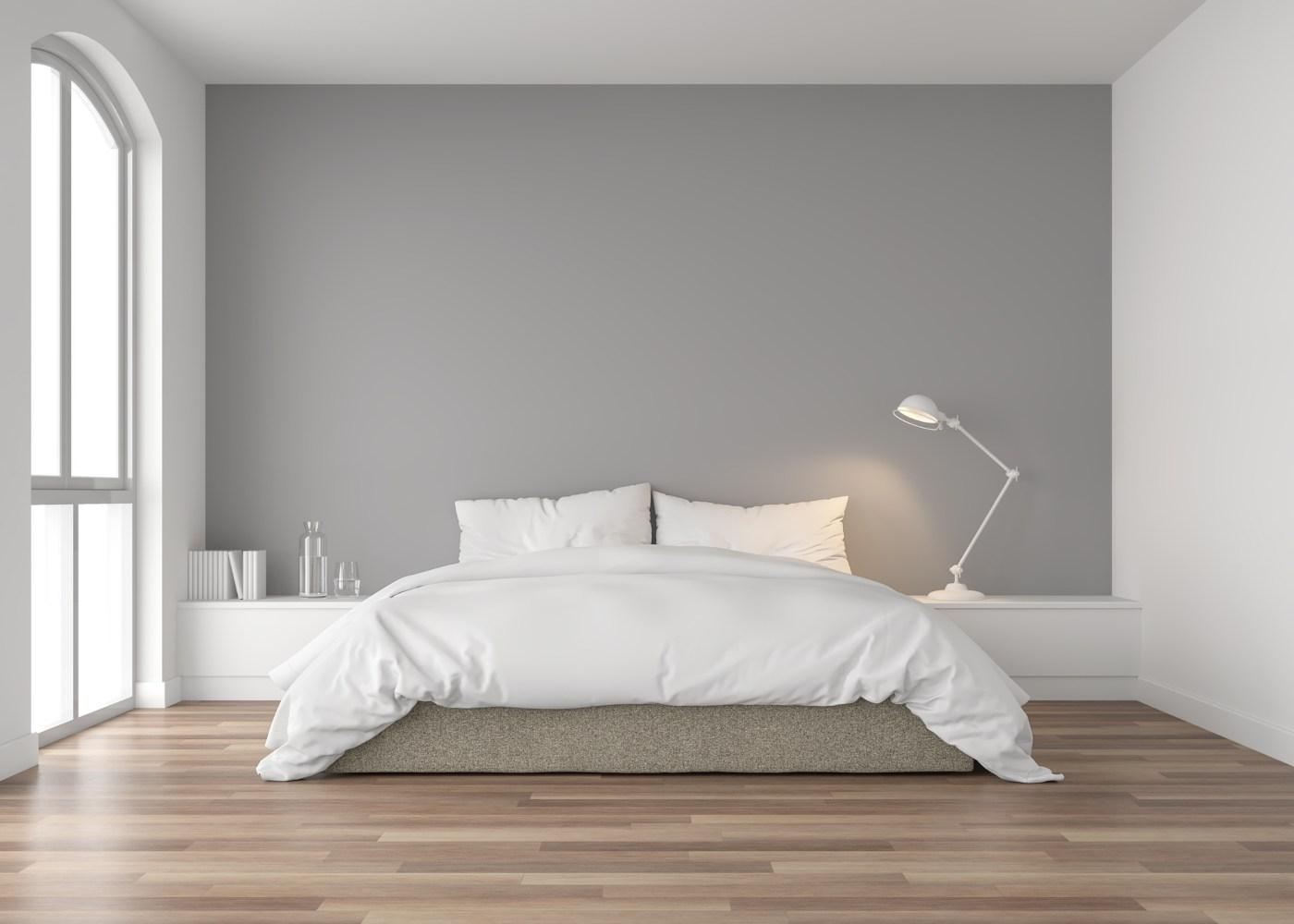 quarto em tons de branco e cinzento decorado segundo orientações de coisas que não deve ter no quarto