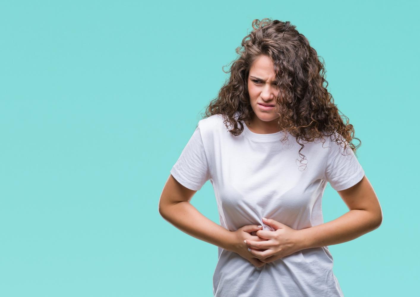 Mulher com dores de diarreia