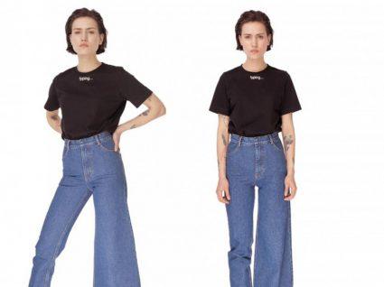 Mulher com calças de ganga assimétricas