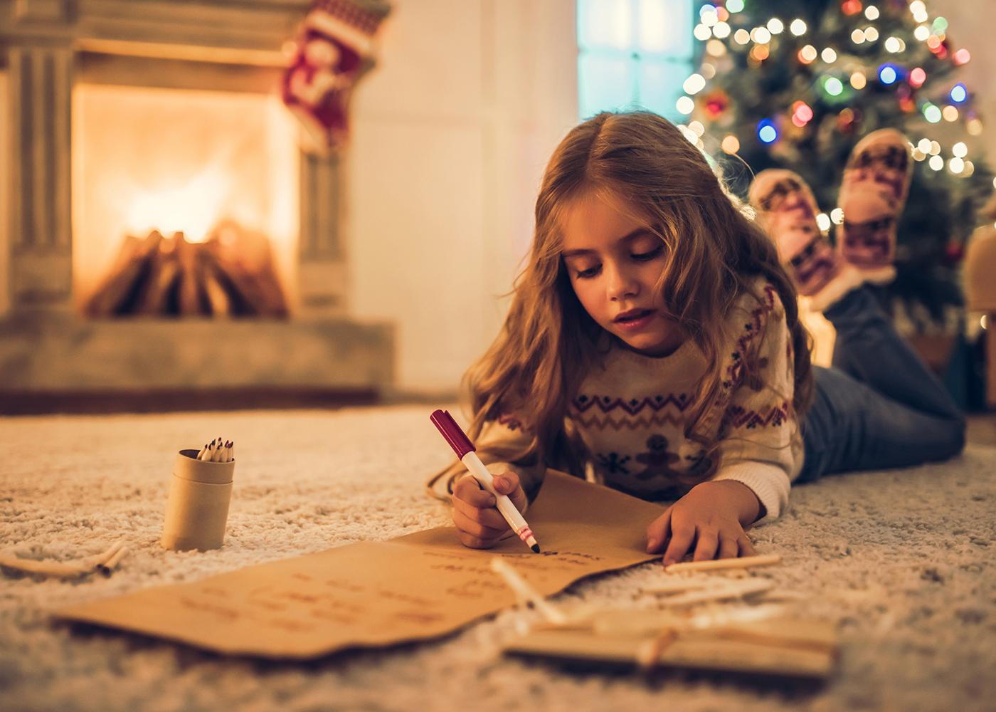 menina escreve carta ao pai natal