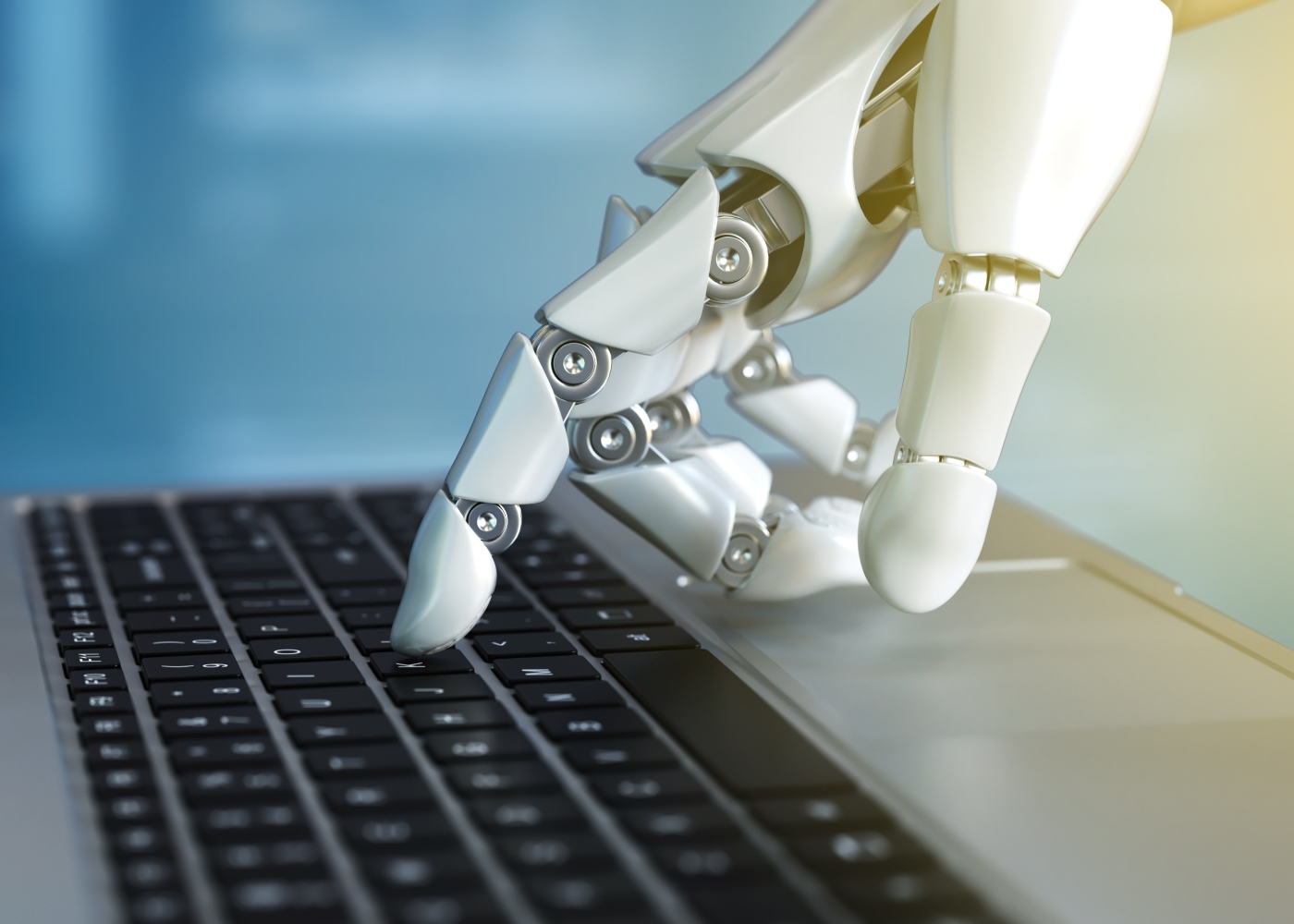 mão robotizada a mexer em teclado de computador